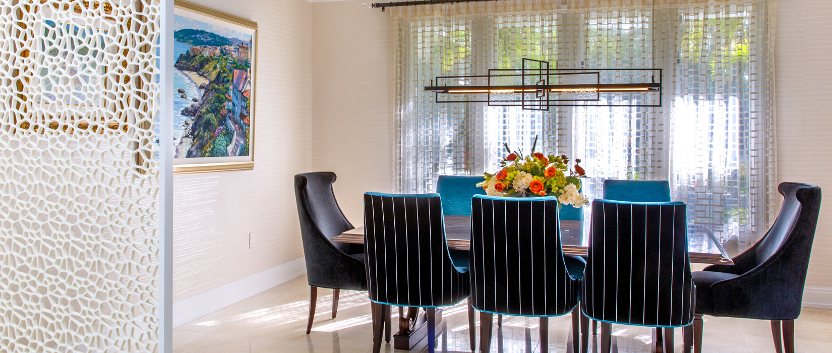 Contemporary dining room featuring summer pendant by Hubbardton Forge